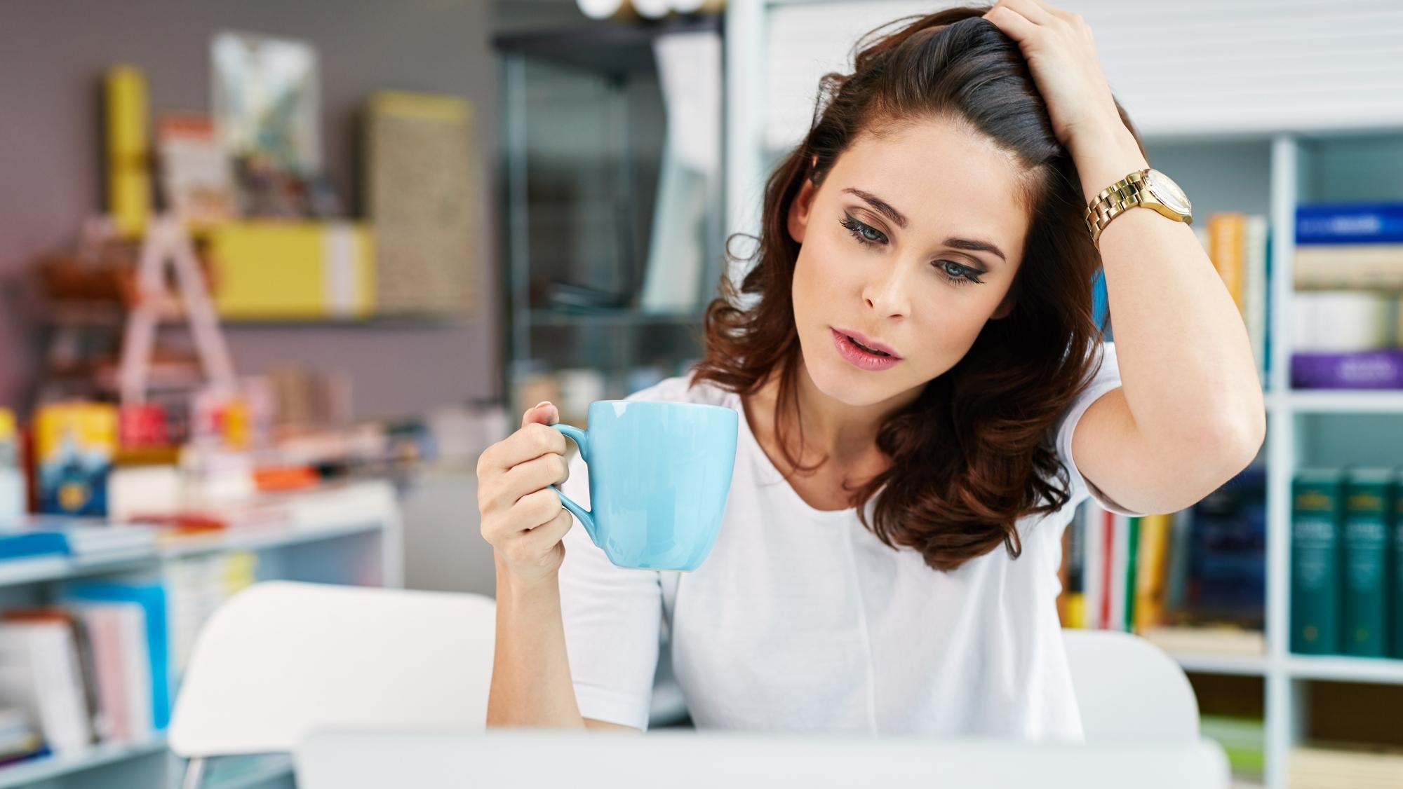 worried-woman-working-on-laptop